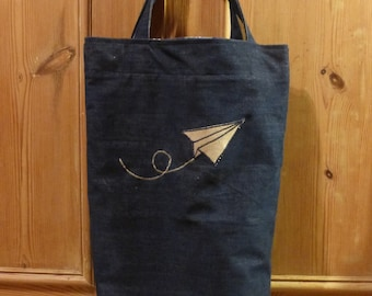 Shopping bag with paper airplane