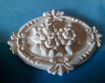 White plaster oval rosette flower gm has paint