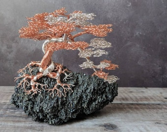 A non tarnishing 0.5mm copper and non tarnishing silver plated copper wire bonsai tree attached to a silicon carbonate base.