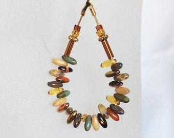 Ethnic metal earrings Golden drop pendant glass grain of rice, amber and jade beads