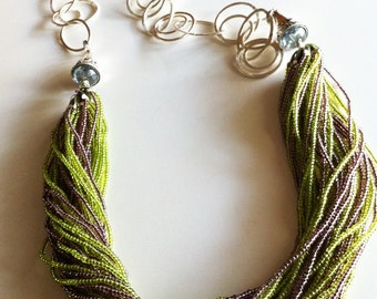 Green & Purple beads with balinese strealing silver design