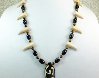 Black and White Bone Pendant on a 23 inches long Brown Tiger's Eye and Black Agate Beaded Necklace with Off White Imitation Talon Fang Beads
