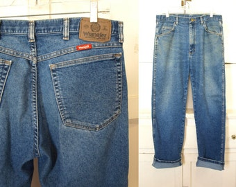 Vintage 1970s Wrangler high waist straight legged distressed patched faded bashed bleached biker rocker grunge jeans. Size: 30/32 8/10/12?
