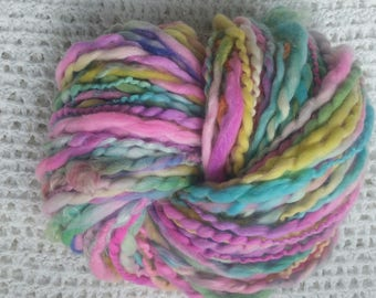 POPSICLE skein of handspun wool with spinning wheel