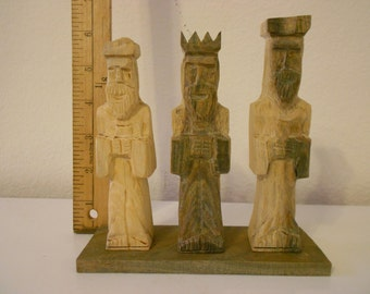 Three mens wise carved wood statue
