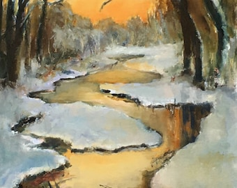 Golden Sunset reflecting on winter stream and snow with trees in background.