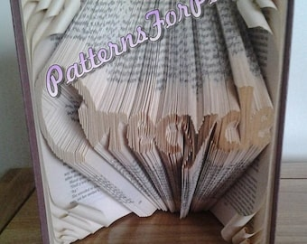 Book folding pattern for a RECYCLE logo