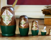 modern matryoshka nesting dolls in emerald green, unique home decor, four floral and geometric dolls with quartz crystal