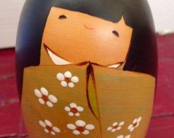 Japanese Kokeshi doll - green flowered robe and long black hair with bangs