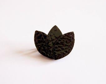 Black patent leather petals brooch