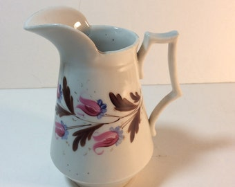 Early antique hand painted syrup or cream pitcher.