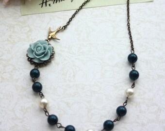 A Soft Blue Rose Flower, Swarovski Ivory, Midnight Blue Pearls Antiqued Brass Necklace.  Bridesmaid Gifts. Blue Wedding. Something Blue.