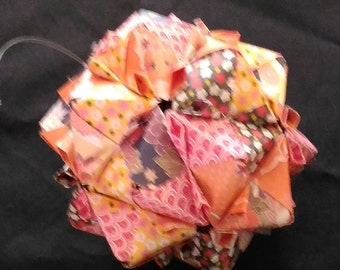 Christmas ball origami paper, orange and pink