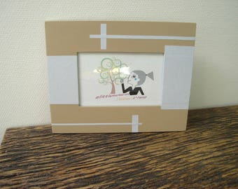 beige line paper with polka dots picture frame