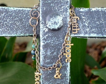 SALE - 20 PECENT OFF - Faith Hope and Love antique brass and lapis bracelet with curlicue hook clasp