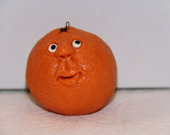 Orange Figure or Ornament with Silly Face