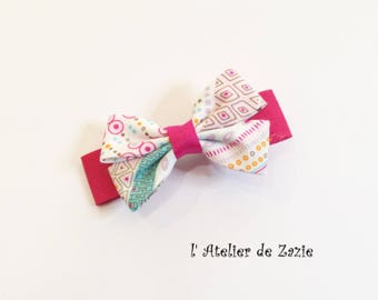 hair clip bow ties on the bias from raspberry cotton and printed through graphic