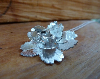 Camellia flower pendant with leaf texture: Handmade, sterling silver