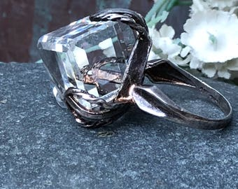 A large clear Quartz  and sterling dress ring size 7