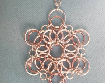 Silver-plated and copper chainmaille flower pendant with glass beads.