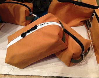 Canvas Dopp Kits.  Designed and sewn in Colorado.  So many uses - shaving kit, makeup bag, tool bag, school supplies, and so much more.