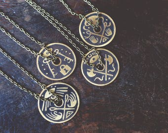 A Solid View - brass shield necklace