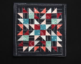 Multi-colored miniature block quilted wallhanging