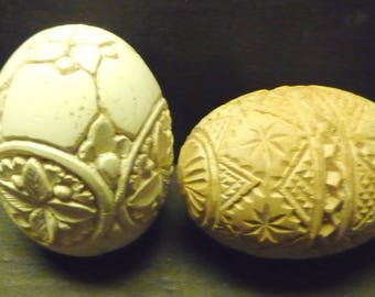 Hand Carved Meerschaum Eggs- one white and one beige wood.