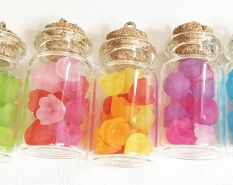 5 pcs of Assorted  glass bottle with flower pendant 49x22mm, bottle with flower, stopper and screw eye