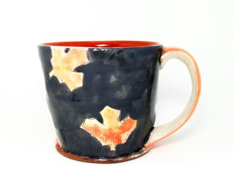 Grey maple leaf themed Earthenware mug. Wheel thrown, food safe leafy mug made by Kaitlyn Brennan