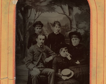 Tintype of group in paper frame- 1/4 plate