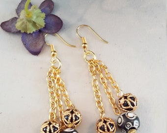 Black and gold earrings, Gold filigree over black beads and black Czech glass beads on triple gold chains