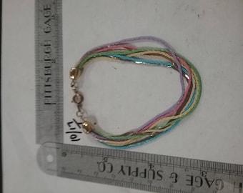 """Used multi color multi strand bracelet 7"""""""