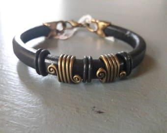 Black thick leather strap.  bronze. men's bracelet