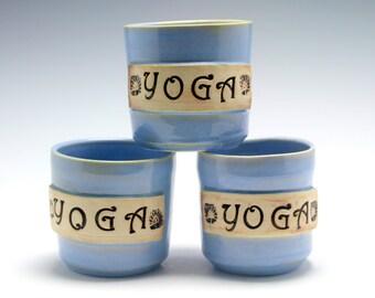 HALF PRICE handmade ceramic yunomi teabowl light blue with the word YOGA/Ceramics and Pottery