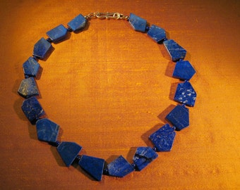 Lapis Lazuli necklace. Attractive flat Lapis stones with small beads between. Sits well on the neck.