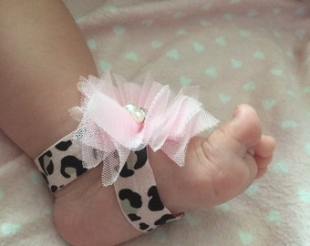 Pink leopard with pink bow