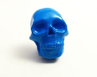 Tiny royal blue Skull lapel pin