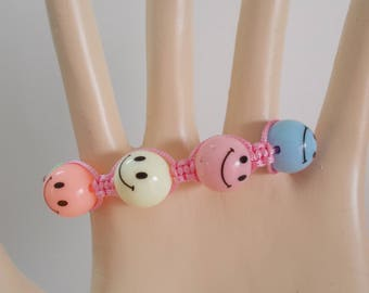 Pink bracelet pastel colors for child or teen yarn SMILE