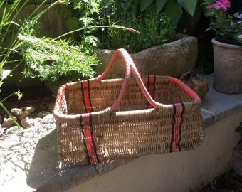 Original vintage 1950s wicker shopping basket red and black trim.