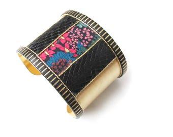 Cuff-inspired art deco brass and black flower pattern