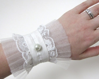 White lace wedding cuff bracelet with pleated organza, white fabric and single glass pearl
