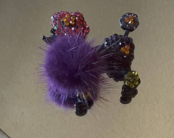 Purple poodle with feathers and rhinestone brooch