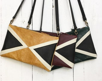 Leather clutch bag with duel triangle detail and detachable strap
