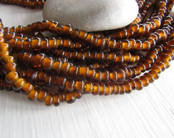Brown lampwork rondelle Glass beads, small transparent glossy  , disc Spacer washer, Indonesian 6.5 to 8mm dia ( 10 inches ) 7ab28-8