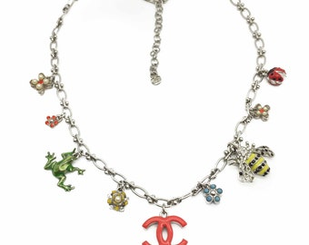CHANEL Jewelry Necklace Vintage 'The GARDEN' Season 2004 Charm Necklace feat. 10 charms on a fancy loop & ball chain. Full Chanel Markings.