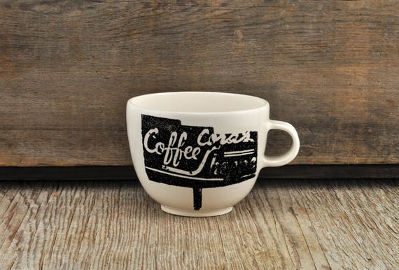 Porcelain coffee cup with vintage COFFEE SHOP sign