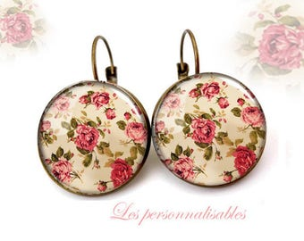 fields of roses in bronze with glass dome earrings. ..