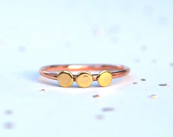 The three dot ring