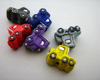4 Tiny Semi Truck Beads - mixed